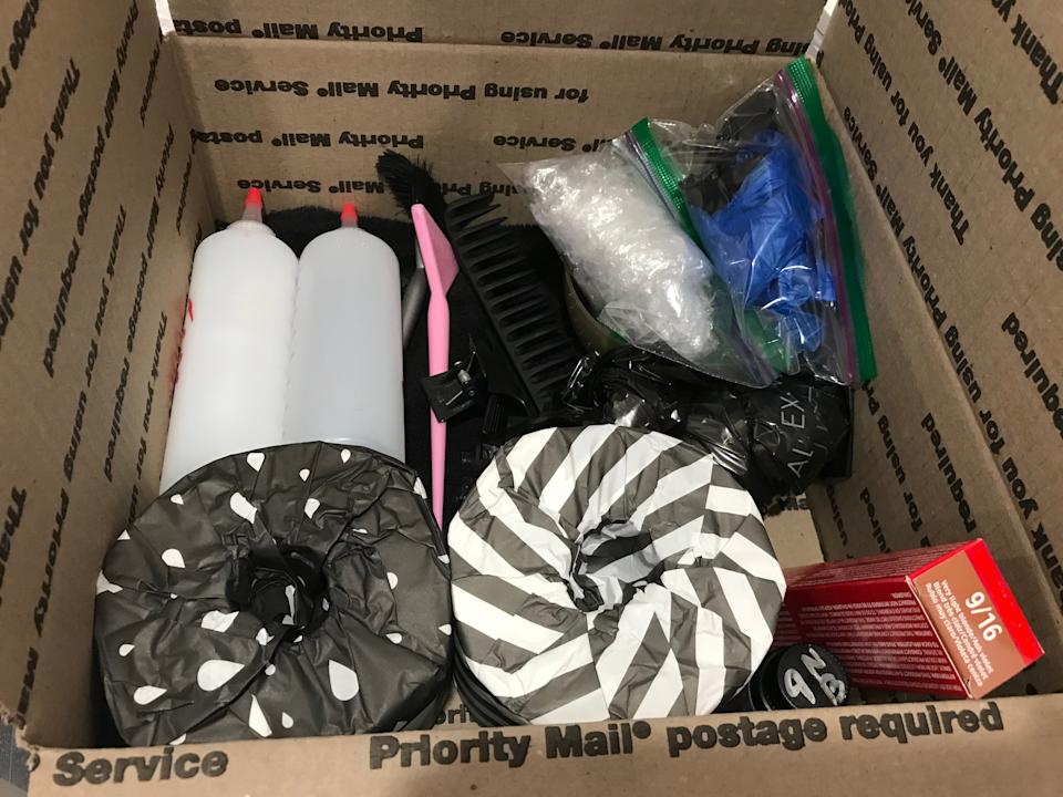 Care package from Naomi Knights to a client, including hair color, mixing bottles, and toilet paper