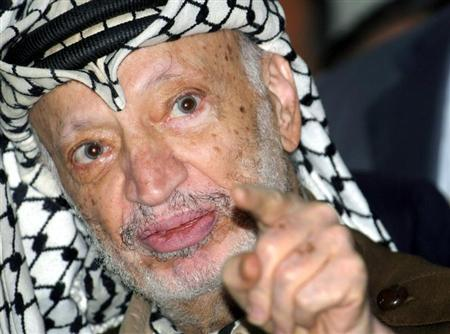 Palestinian President Yasser Arafat talks to the media after opening a voter registration drive at a ...