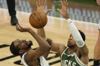 Milwaukee Bucks' Giannis Antetokounmpo knocks the ball from Brooklyn Nets' Kevin Durant during the second half of Game 3 of the NBA Eastern Conference basketball semifinals game Thursday, June 10, 2021, in Milwaukee. (AP Photo/Morry Gash)