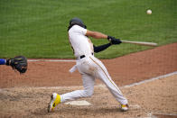 Pittsburgh Pirates' Cole Tucker drives in two runs with a single off Chicago Cubs relief pitcher Jason Adam during the sixth inning of a baseball game in Pittsburgh, Thursday, Sept. 3, 2020. (AP Photo/Gene J. Puskar)