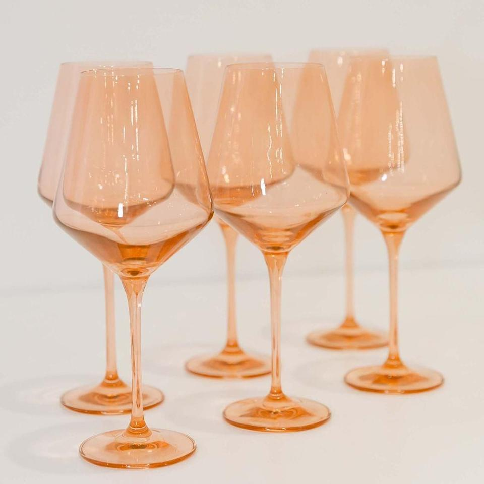 <p>These <span>Estelle Colored Glass Stemmed Wine Glasses</span> ($175 (Set of 6) are so cheerful.</p>