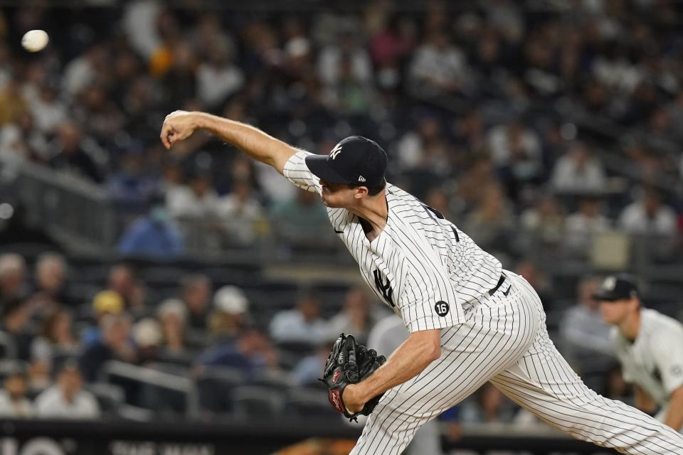 New York Yankees' Clay Holmes delivers a pitch during the seventh inning of a baseball game against the Texas Rangers, Monday, Sept. 20, 2021, in New York. (AP Photo/Frank Franklin II)