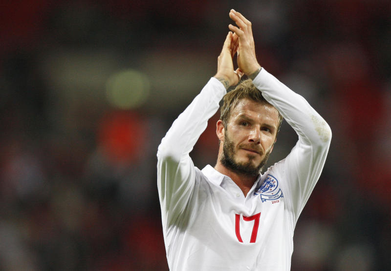 """FILE This Wednesday, Oct. 14, 2009 file photo shows England's David Beckham applauding the crowd after their World Cup group 6 qualifying soccer match against Belarus at Wembley Stadium, London. Former England captain David Beckham has failed to make the British football team for the London Olympics. The Los Angeles Galaxy midfielder made Britain coach Stuart Pearce's shortlist of 35 but wasn't selected for the final 18-man squad as one of three players over the age of 23 allowed to compete in the games. """"Everyone knows how much playing for my country has always meant to me, so I would have been honored to have been part of this unique Team GB squad,"""" the 37-year-old Beckham said Thursday June 28, 2012 in a statement to The Associated Press.(AP Photo/Kirsty Wigglesworth)"""