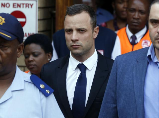 Olympic and Paralympic track star Oscar Pistorius leaves the court after the fourth day of his trial for the murder of his girlfriend Reeva Steenkamp at the North Gauteng High Court in Pretoria, March 6, 2014. REUTERS/Mike Hutchings (SOUTH AFRICA - Tags: SPORT ATHLETICS CRIME LAW)