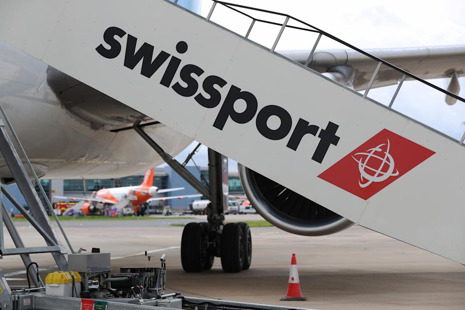 Swissport moving staircase at Luton Airport. (Photo by Jonathan Brady/PA Images via Getty Images)