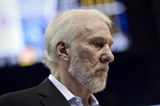 San Antonio Spurs head coach Gregg Popovich stands on the court in the first half of an NBA basketball game against the Memphis Grizzlies Wednesday, Jan. 24, 2018, in Memphis, Tenn. (AP Photo/Brandon Dill)
