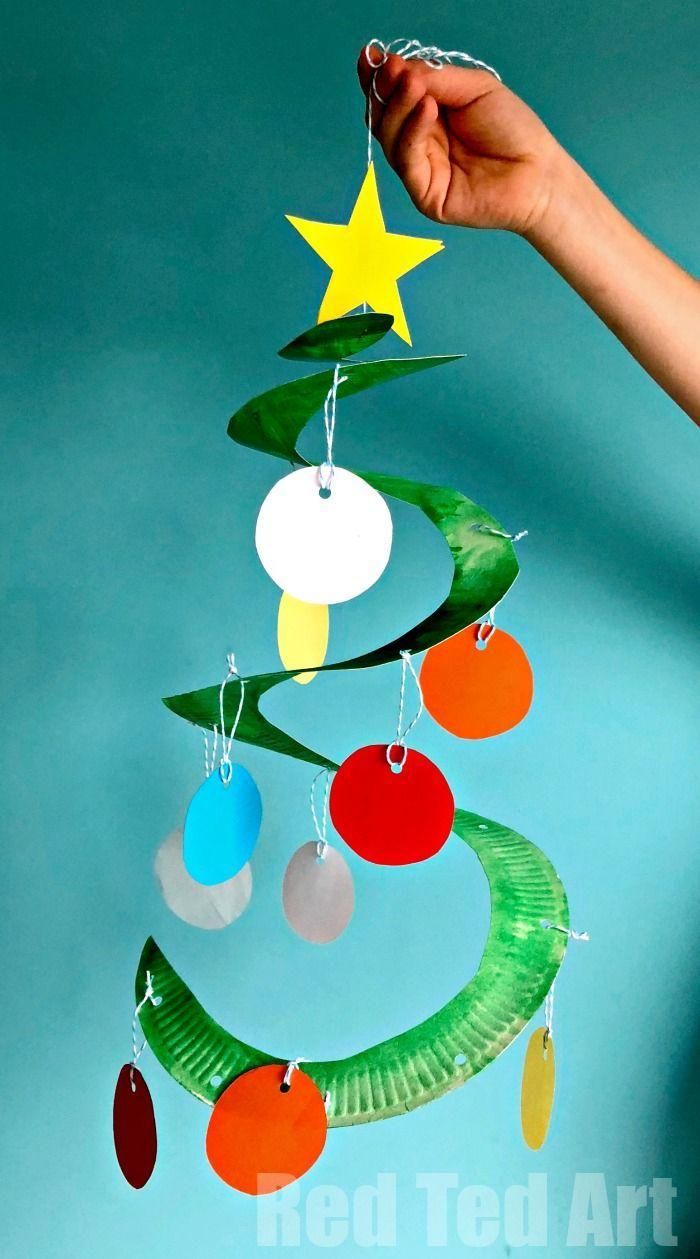"<p>When it's Christmastime, you can never have too many trees around your house. Add one more to the bunch by cutting a spiral shape into a paper plate. To finish your tree, attach ""ornaments"" to each level using string and top it off with a star.</p><p><strong>Get the tutorial at <a href=""https://www.redtedart.com/paper-plate-christmas-tree-whirligig/"" rel=""nofollow noopener"" target=""_blank"" data-ylk=""slk:Red Ted Art"" class=""link rapid-noclick-resp"">Red Ted Art</a>.</strong></p><p><a class=""link rapid-noclick-resp"" href=""https://www.amazon.com/Perfectware-Paper-Plate-6-300-White/dp/B07F22HHVH/ref=sr_1_2_sspa?tag=syn-yahoo-20&ascsubtag=%5Bartid%7C10050.g.5030%5Bsrc%7Cyahoo-us"" rel=""nofollow noopener"" target=""_blank"" data-ylk=""slk:SHOP PAPER PLATES"">SHOP PAPER PLATES</a></p>"