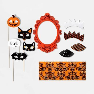 photo booth props and paper shapes attached to bamboo sticks