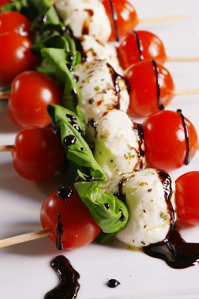 """<p>This is the easiest buffet appetiser that always wins.</p><p>Get the <a href=""""https://www.delish.com/uk/cooking/recipes/a28827847/caprese-bites-recipe/"""" target=""""_blank"""">Caprese Bites</a> recipe. </p>"""