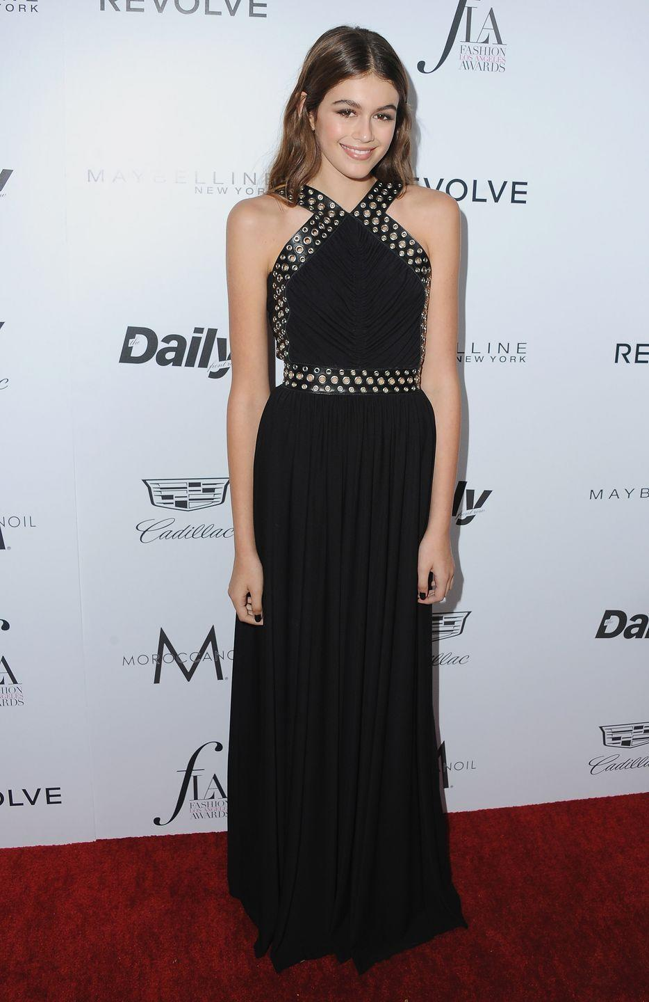 <p>Before her fashion career kicked off, the model wore a floor-length black gown to the Daily Front Row 'Fashion Los Angeles Awards' 2016 </p>