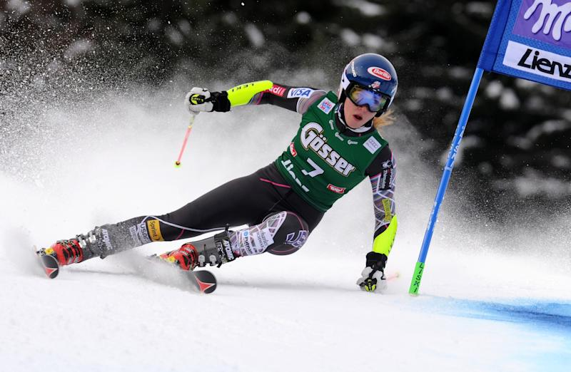 Mikaela Shiffrin, of the US, speeds down the course during the first run of an alpine ski, women's World Cup giant slalom, in Lienz, Austria, Saturday, Dec. 28, 2013. (AP Photo/Marco Tacca)