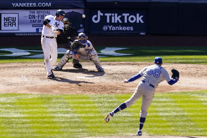 New York Yankees' Jay Bruce, left, hits a two-run single off Toronto Blue Jays relief pitcher Tim Mayza, right, during the sixth inning of a baseball game, Saturday, April 3, 2021, in New York. (AP Photo/John Minchillo)