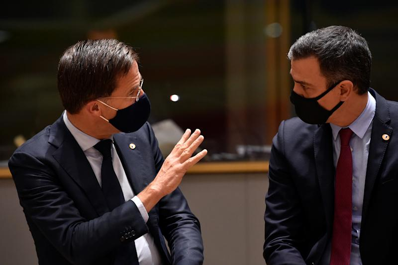 Spain's Prime Minister Pedro Sanchez and Dutch Prime Minister Mark Rutte speak during the first face-to-face EU summit since the coronavirus disease (COVID-19) outbreak, in Brussels, Belgium July 20, 2020. John Thys/Pool via REUTERS