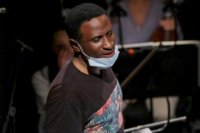 Canadian conductor Kwame Ryan, who grew up in Trinidad and Tobago before completing his training in Britain, found the mix of musical styles an inspiration and a challenge (AFP/François WALSCHAERTS)