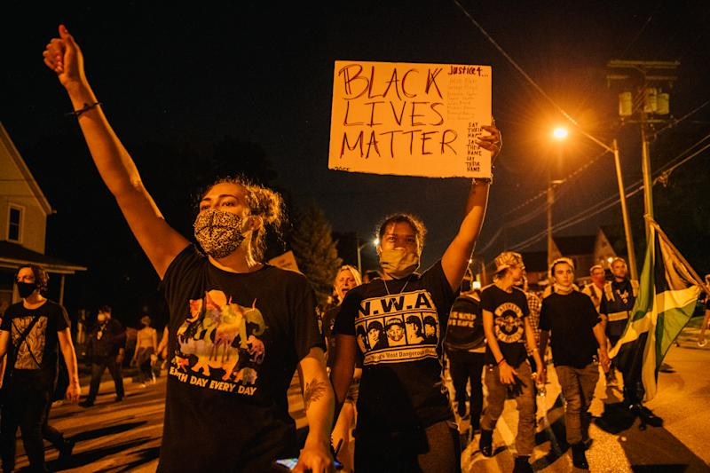Protesters take to the streets in Kenosha, Wis., where police shot Jacob Blake — in front of his three children — leaving him partially paralyzed. (Photo: Brandon Bell/Getty Images)
