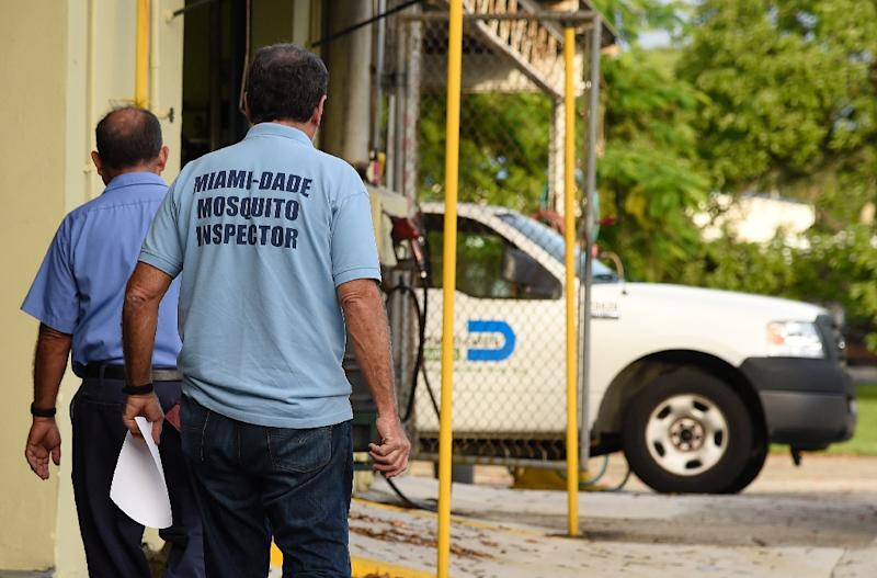 Mosquito control workers search homes for the Aedes aegypti mosquito in Miami, where the US last month announced its first locally transmitted cases of Zika (AFP Photo/Rhona Wise)