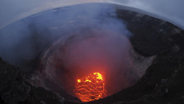 <p>This May 6, 2018 photo shows the lava lake at the summit of Kilauea near Pahoa, Hawaii. Hawaii's erupting Kilauea volcano has destroyed homes and forced the evacuations of more than a thousand people. (Photo: U.S. Geological Survey via AP) </p>