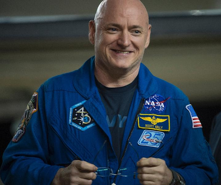 NASA astronaut Scott Kelly said his skin was very sensitive after his 340 days in space, adding he was wearing dress shoes only because of his televised appearance, and a more comfortable pair was waiting nearby (AFP Photo/NASA/Joel Kowsky)