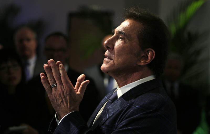 FILE - In this March 15, 2016 file photo, casino mogul Steve Wynn gestures during a news conference in Medford, Mass. A former beauty salon director from Las Vegas who went public about sexual misconduct allegations against casino mogul Steve Wynn is suing Wynn Resorts and executives, alleging they invaded his privacy and spied on him at his next job in a bid to undercut his accounts. (AP Photo/Charles Krupa, File)
