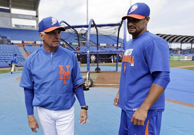FILE - In this March 6, 2013, file photo, New York Mets manager Terry Collins, left, talks to pitcher Johan Santana before an exhibition baseball game against Venezuela in Port St. Lucie, Fla. The Mets have declined a $25 million option on the injured pitcher on Friday, Nov. 1, 2013, and will pay the left-hander a $5.5 million buyout. Santana will be 35 next season and becomes a free agent. (AP Photo/Julio Cortez, File)