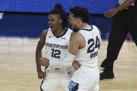 Memphis Grizzlies' Ja Morant, left, is congratulated by Dillon Brooks after scoring against the Golden State Warriors during overtime in an NBA basketball Western Conference play-in game in San Francisco, Friday, May 21, 2021. (AP Photo/Jed Jacobsohn)