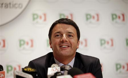 Florence Mayor Renzi, newly elected secretary of Democratic Party (PD), listens to reporter question during a news conference in Rome