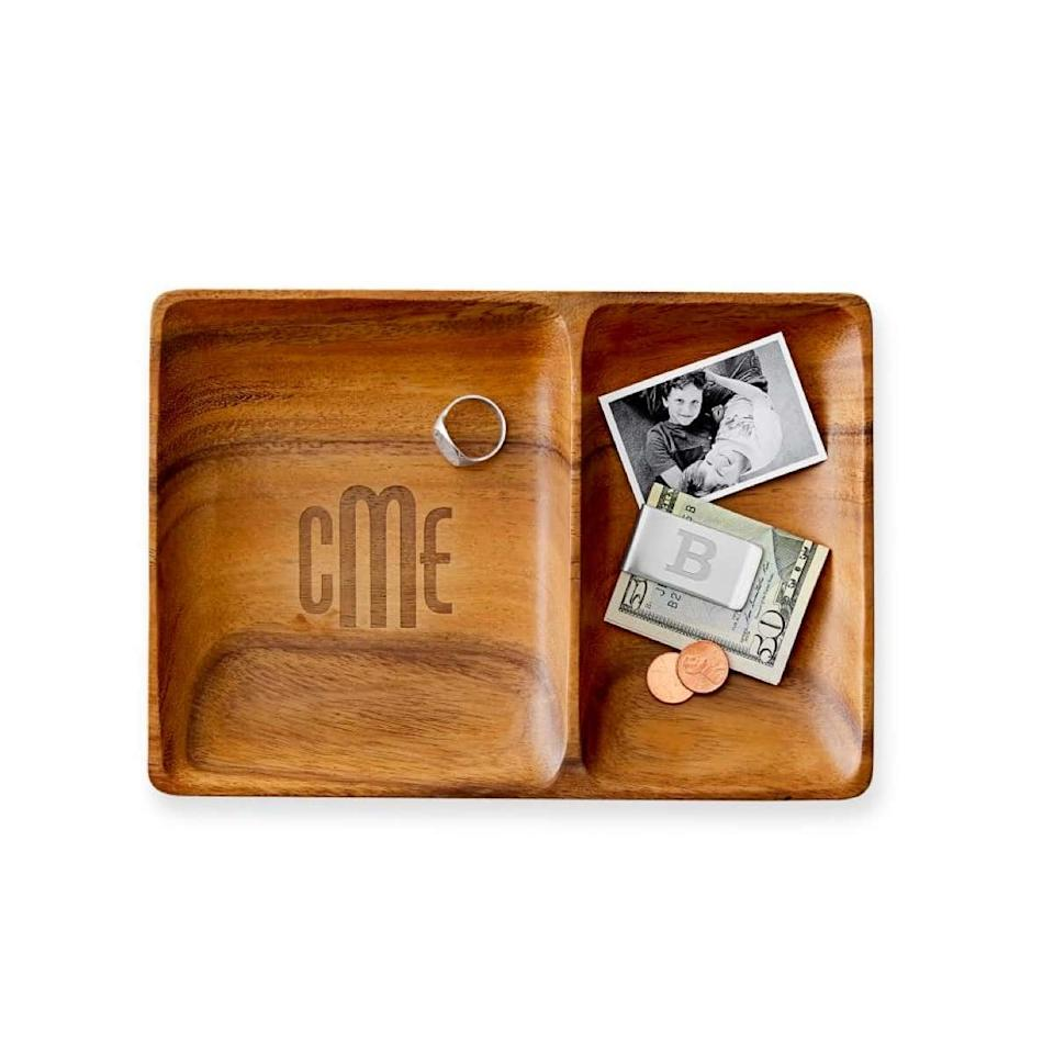 """Does your boyfriend's miscellaneous drawer always seem to be overflowing out into his living space? Keep his junk in check with a monogrammed catch-all tray. $49, Mark & Graham. <a href=""""https://www.markandgraham.com/products/acacia-valet"""">Get it now!</a>"""