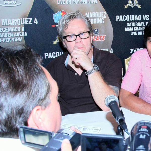 BEVERLY HILLS, CA - SEPTEMBER 17: (L-R) Trainer Freddie Roach looks on as boxer Manny Pacquiao answers questions from the print media after the Manny Pacquiao v Juan Manuel Marquez - Press Conference at Beverly Hills Hotel on September 17, 2012 in Beverly Hills, California. (Photo by Victor Decolongon/Getty Images)