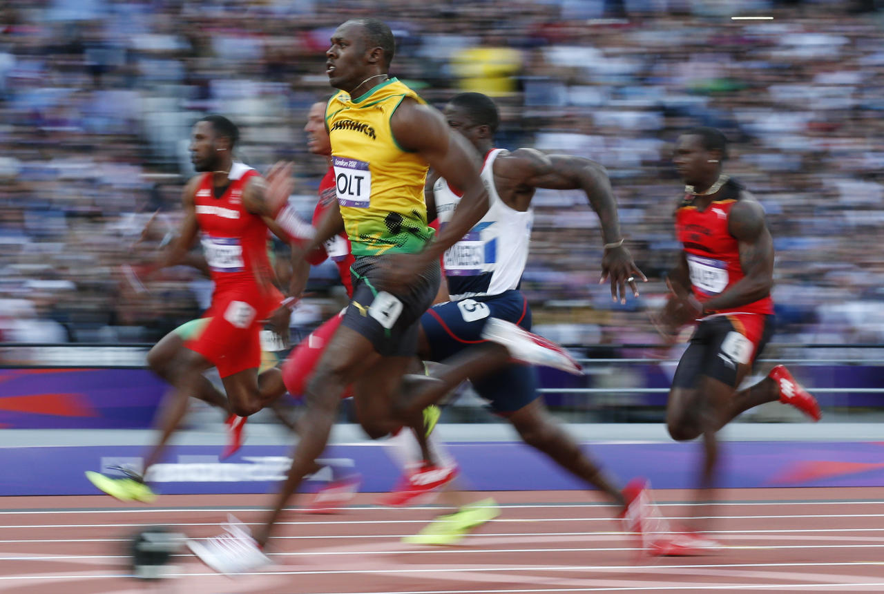 Jamaica's Usain Bolt competes in a men's 100-meter semifinal during the athletics in the Olympic Stadium at the 2012 Summer Olympics, London, Sunday, Aug. 5, 2012. (AP Photo/Matt Dunham)