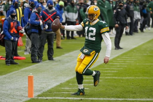 Green Bay Packers' Aaron Rodgers runs for a touchdown during the first half of an NFL football game against the Jacksonville Jaguars Sunday, Nov. 15, 2020, in Green Bay, Wis. (AP Photo/Matt Ludtke)