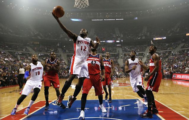 Detroit Pistons guard Will Bynum (12) scores on the Washington Wizards in the first half of an NBA basketball game in Auburn Hills, Mich., Wednesday, Oct. 30, 2013. (AP Photo/Paul Sancya)