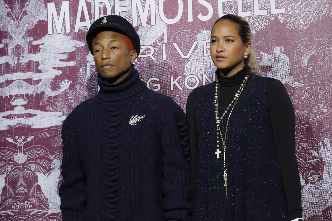 <p>American rapper-producer Pharrell Williams and his wife, Helen Lasichanh at the CHANEL Mademoiselle Privé Exhibition in Hong Kong</p>