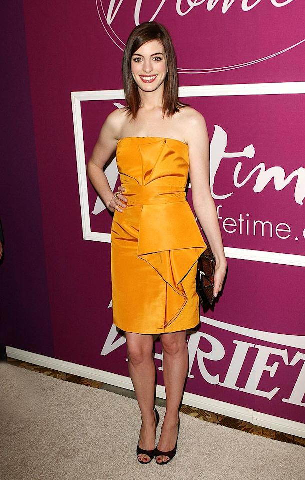 "Back in Beverly Hills, Anne Hathaway nearly took our breath away in an apricot Lela Rose dress and Roger Vivier pumps upon arriving at <i>Variety</i>'s Power of Women Luncheon. Jason Merritt/<a href=""http://www.gettyimages.com/"" target=""new"">GettyImages.com</a> - September 24, 2009"