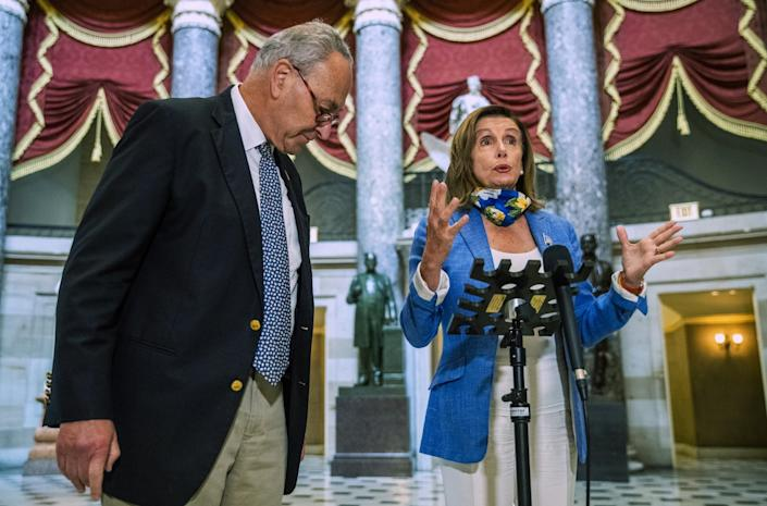 """House Speaker Nancy Pelosi (D-San Francisco) and Senate Minority Leader Charles E. Schumer (D-N.Y.) speak to reporters Saturday after meeting with Trump administration officials. <span class=""""copyright"""">(Manuel Balce Ceneta / Associated Press)</span>"""