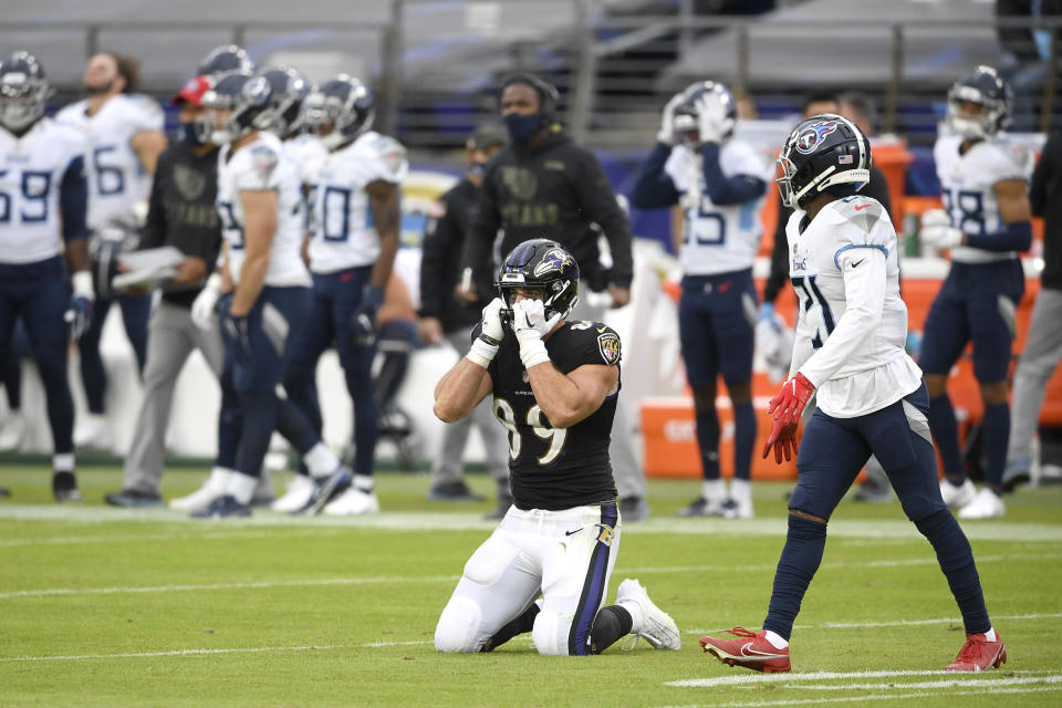 Baltimore Ravens tight end Mark Andrews (89) reacts after failing to catch a pass against Tennessee Titans cornerback Malcolm Butler, right, on a third down play during the second half of an NFL football game, Sunday, Nov. 22, 2020, in Baltimore. The Titans won 30-24 in overtime. (AP Photo/Nick Wass)