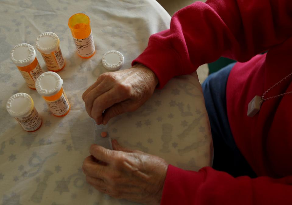 Inez Willis, a senior citizen, sorts her daily medical prescriptions at her independent living apartment in Silver Spring, Maryland April 11, 2012. REUTERS/Gary Cameron   (UNITED STATES - Tags: SOCIETY HEALTH)