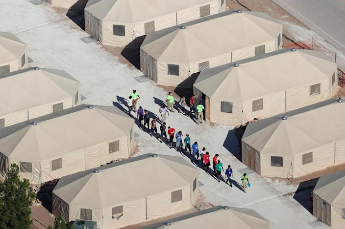 Immigrant children, many of whom have been separated from their parents, are housed in tents next to the Mexican border in Tornillo, Texas, June 2018. (Photo: Mike Blake/Reuters)