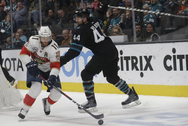 Florida Panthers left wing Jonathan Huberdeau (11) skates with the puck in front of San Jose Sharks defenseman Marc-Edouard Vlasic (44) during the second period of an NHL hockey game in San Jose, Calif., Thursday, March 14, 2019. (AP Photo/Jeff Chiu)