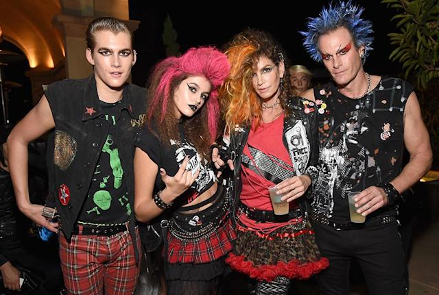 <p>The supermodel and her Casamigos co-founder husband Rande Gerber (along with their kids, Presley and Kaia) went punk for the tequila brand's Halloween bash in Beverly Hills. (Photo: Michael Kovac/Getty Images) </p>