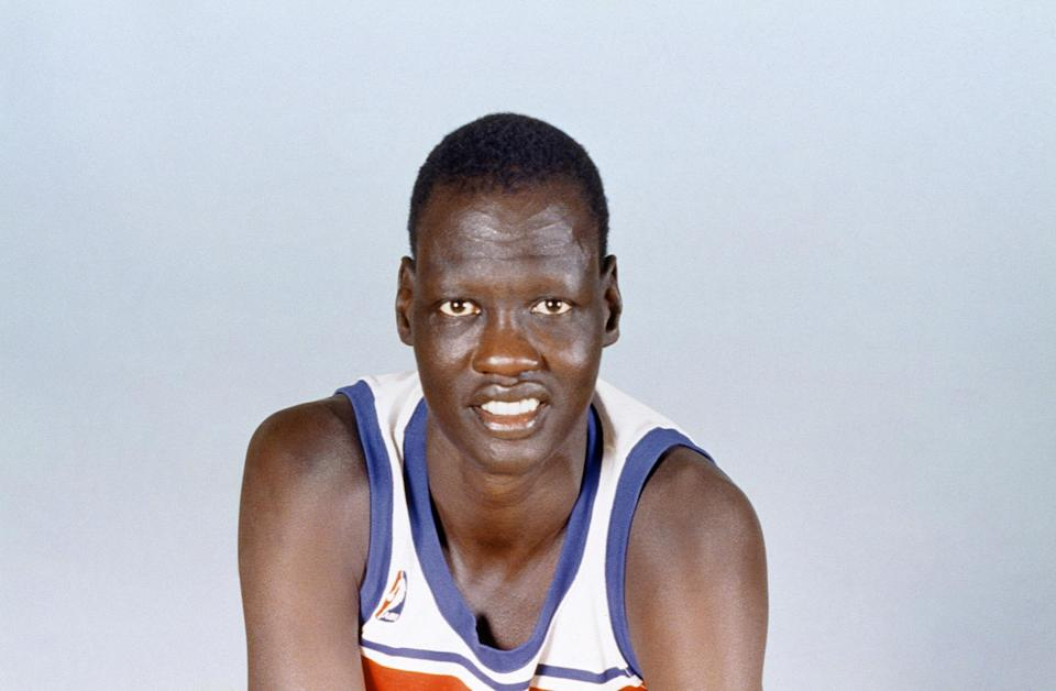 Manute Bol was listed at 23 years old when he joined the Washington Bullets in 1985. (AP)