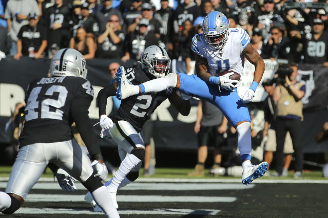 Detroit Lions wide receiver Marvin Jones Jr. (11) catches a touchdown pass against Oakland Raiders' Daryl Worley (20) and Karl Joseph (42) during the first half of an NFL football game in Oakland, Calif., Sunday, Nov. 3, 2019. (AP Photo/John Hefti)