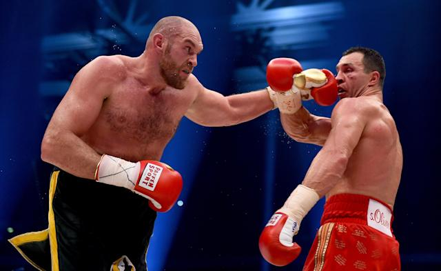 Tyson Fury in action with Wladimir Klitschko during their IBF/IBO/WBA/WBO world heavyweight title fight at Esprit-Arena on Nov. 28, 2015 in Duesseldorf, Germany. (Getty Images)