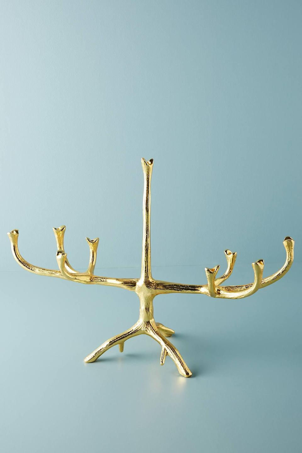 """<p>The <a href=""""https://www.popsugar.com/buy/Gold-Tree-Branch-Menorah-502210?p_name=Gold%20Tree%20Branch%20Menorah&retailer=anthropologie.com&pid=502210&price=198&evar1=casa%3Aus&evar9=46615300&evar98=https%3A%2F%2Fwww.popsugar.com%2Fhome%2Fphoto-gallery%2F46615300%2Fimage%2F46767568%2FGold-Tree-Branch-Menorah&list1=shopping%2Canthropologie%2Choliday%2Cchristmas%2Cchristmas%20decorations%2Choliday%20decor%2Chome%20shopping&prop13=mobile&pdata=1"""" rel=""""nofollow noopener"""" class=""""link rapid-noclick-resp"""" target=""""_blank"""" data-ylk=""""slk:Gold Tree Branch Menorah"""">Gold Tree Branch Menorah</a> ($198) has soft, beautiful branches.</p>"""