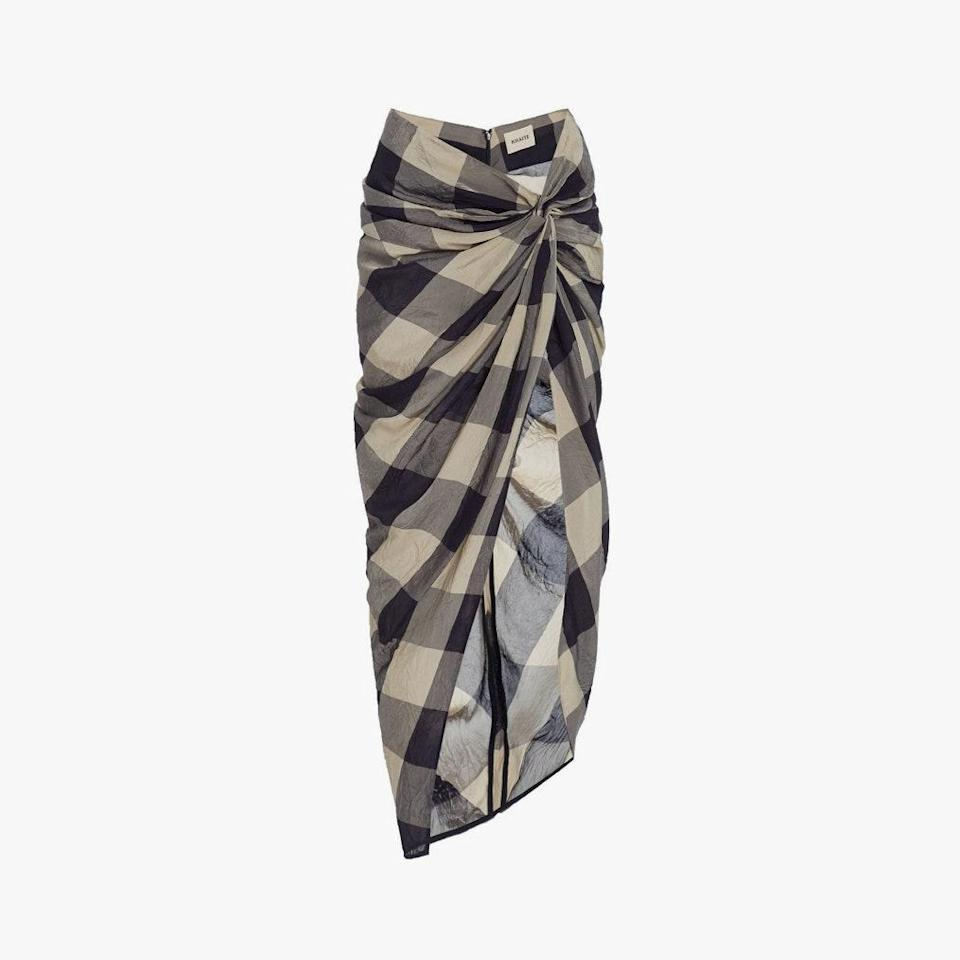 """$980, KHAITE. <a href=""""https://khaite.com/products/the-louie-skirt-in-navy-and-sand-check"""" rel=""""nofollow noopener"""" target=""""_blank"""" data-ylk=""""slk:Get it now!"""" class=""""link rapid-noclick-resp"""">Get it now!</a>"""