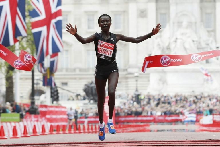 Kenya's Mary Keitany wins the London Marathon with an unofficial time of 2hrs 17min 01sec