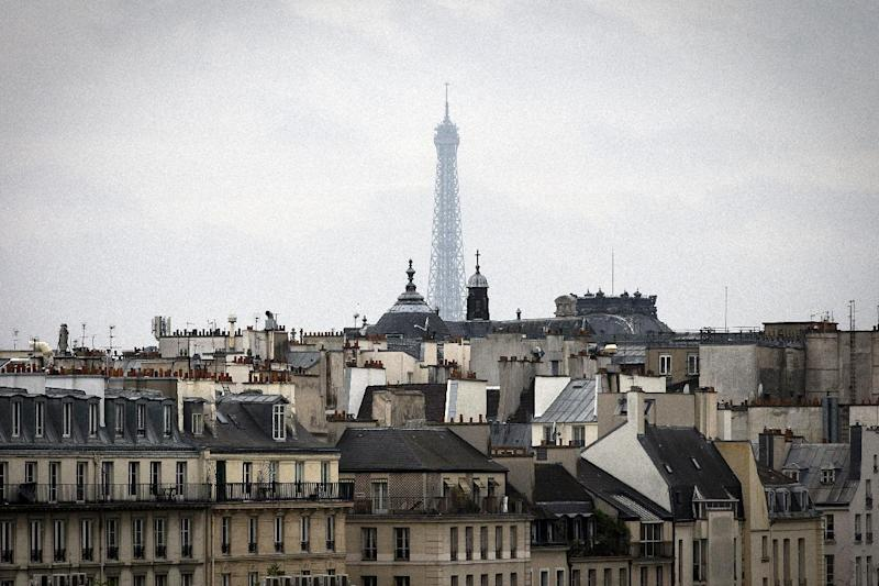 A partial view of the Eiffel Tower is seen in Paris on April 4, 2014