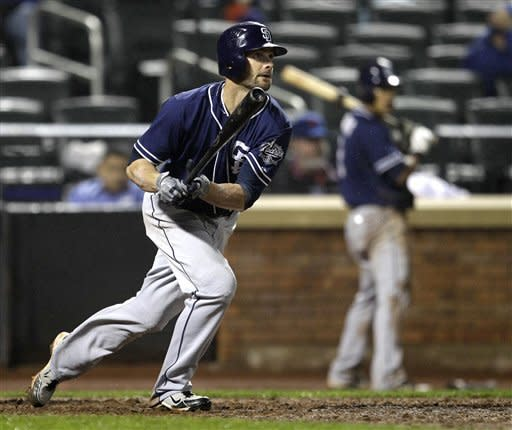 San Diego Padres' Andy Parrino, left, watches his two-run single off New York Mets relief pitcher Manny Acosta in the seventh inning of a baseball game, Thursday, May 24, 2012, in New York. (AP Photo/Kathy Willens)