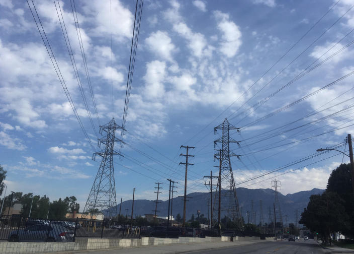Electrical grid transmission towers are seen in Pasadena, California on August 15, 2020. The operator of the state's power grid declared an emergency Friday evening, Aug. 14, and ordered utilities to shed their power loads. / Credit: John Antczak/AP