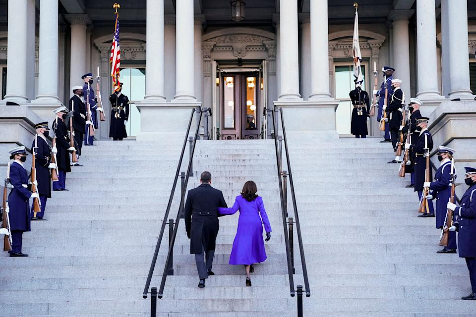 Vice President Kamala Harris and her husband Douglas Emhoff walk into the Eisenhower Executive Office Building on the White House, in Washington on January 20, 2021. (Erin Scott/Reuters)