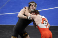 Oklahoma State's Daton Fix, right, takes on Iowa's Austin DeSanto during their 133-pound match in the semifinal round of the NCAA wrestling championships Friday, March 19, 2021, in St. Louis. (AP Photo/Jeff Roberson)